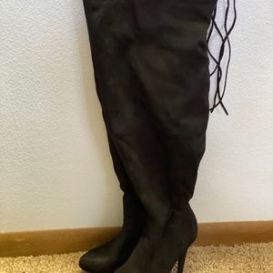 Woman's thigh high black boots